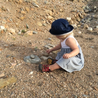 Stacking rocks in the creek bed south of the development